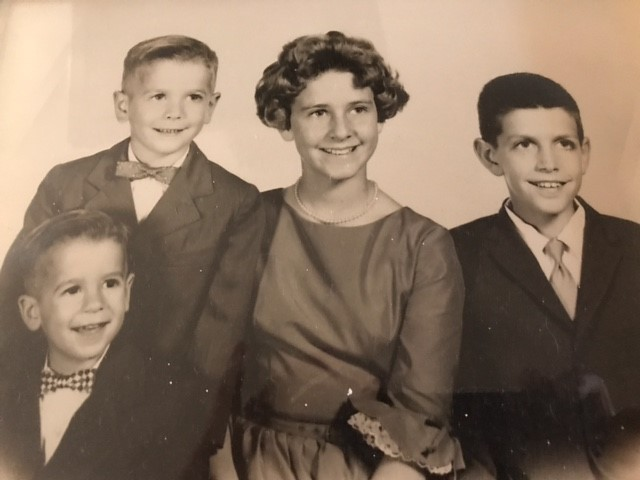 Julian as a young boy with family